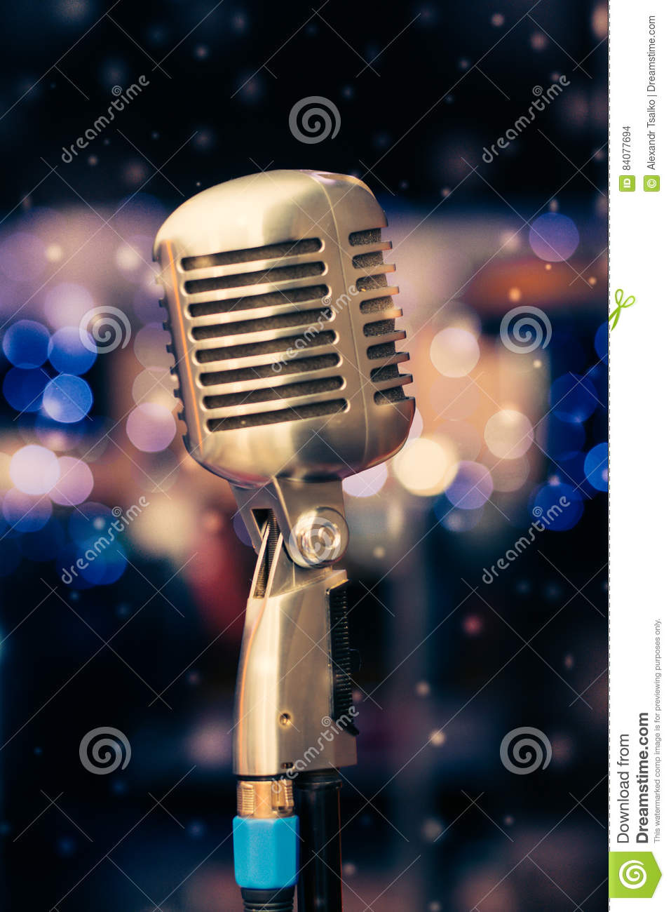 Microphone On A Background Of Blue Lights Stock Photo