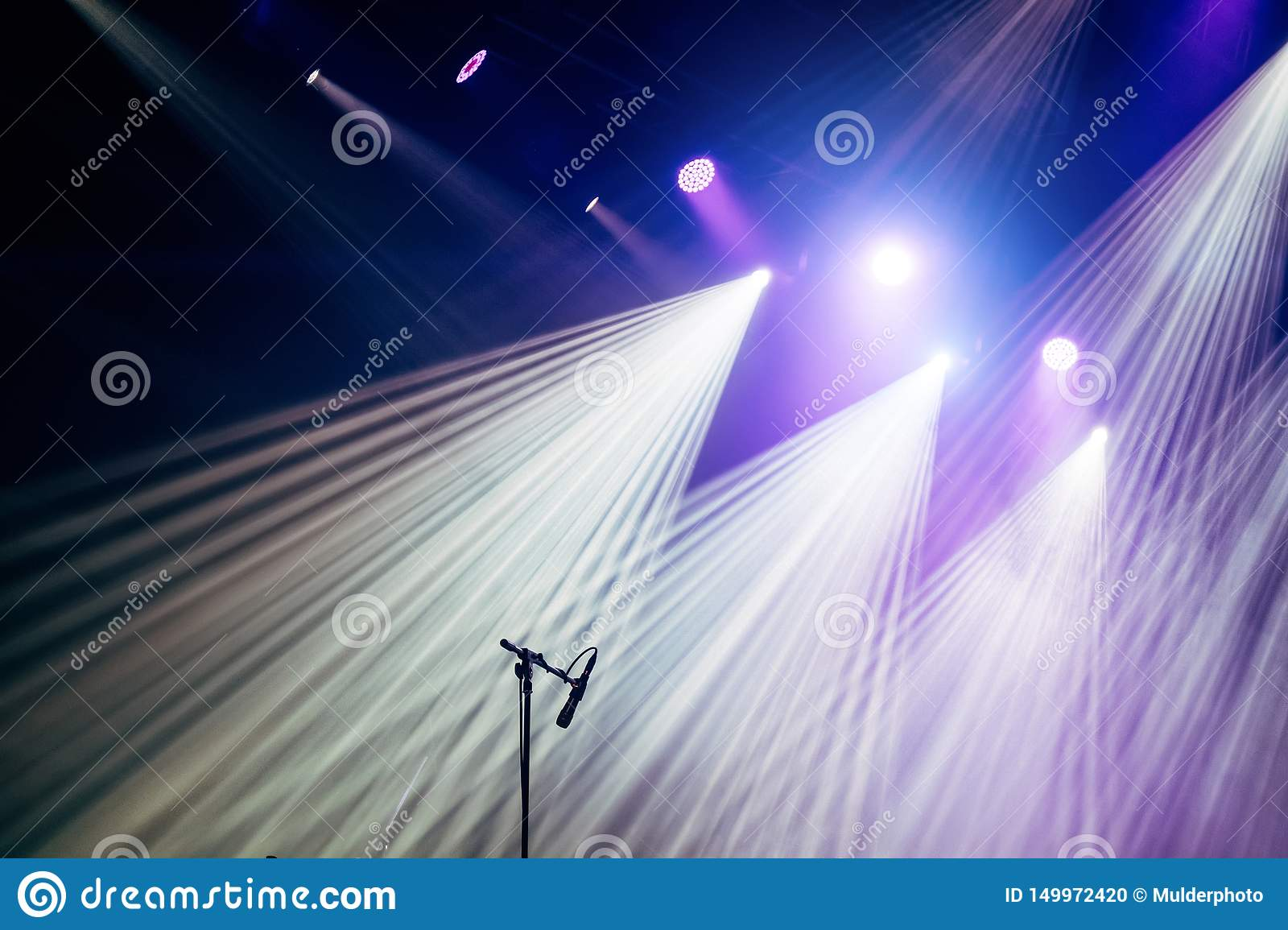 Microphone and bright rays of light on stage before the concert begins