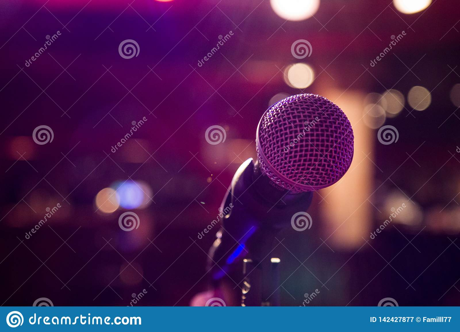 Microphone on the colorful background with bokeh