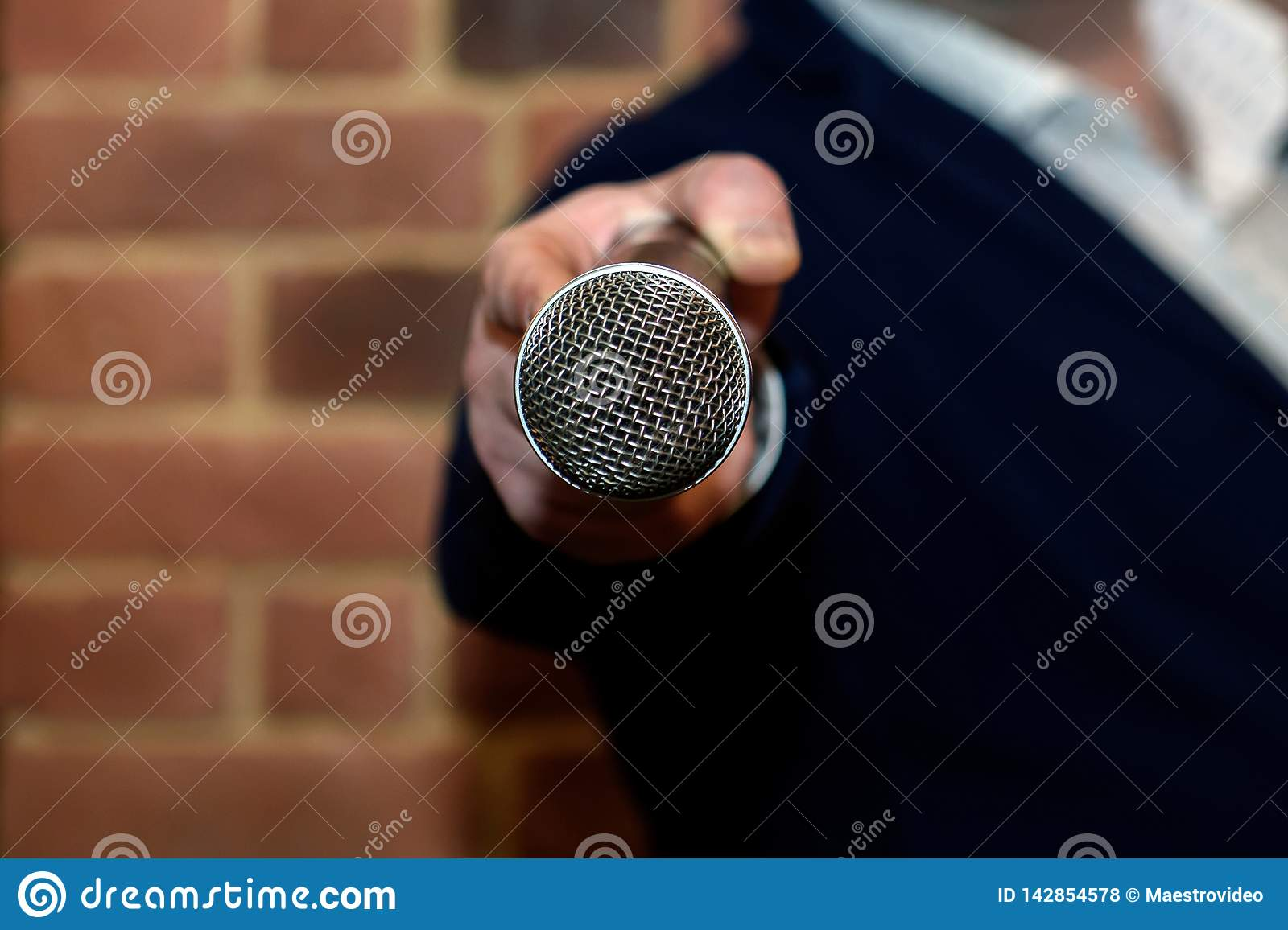 Microphone in the interviewer`s hand