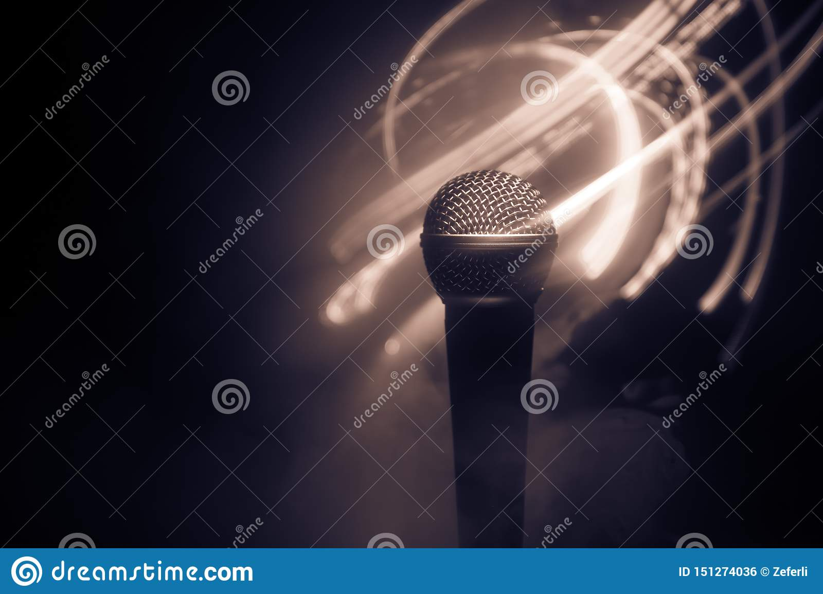 Microphone karaoke, concert . Vocal audio mic in low light with blurred background. Live music, audio equipment. Karaoke concert,