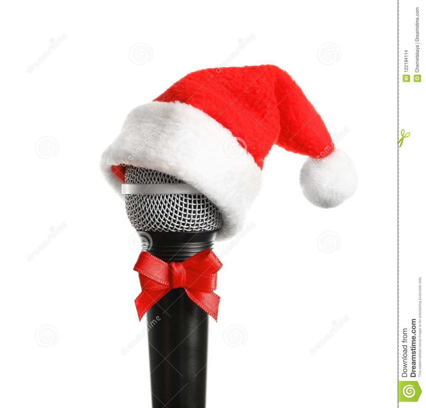 daaafc8ab2005 Microphone with Santa hat and bow on white background. Christmas music  concept