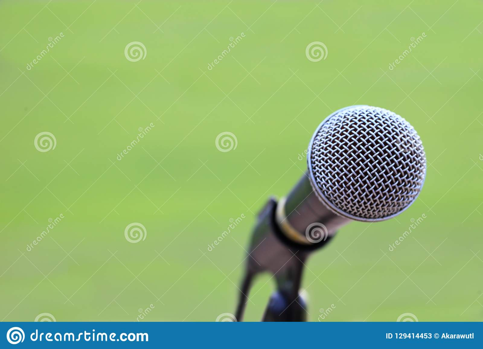 microphone stand on the grass field for announcing for outdoor sport and announcement concept design with copy space