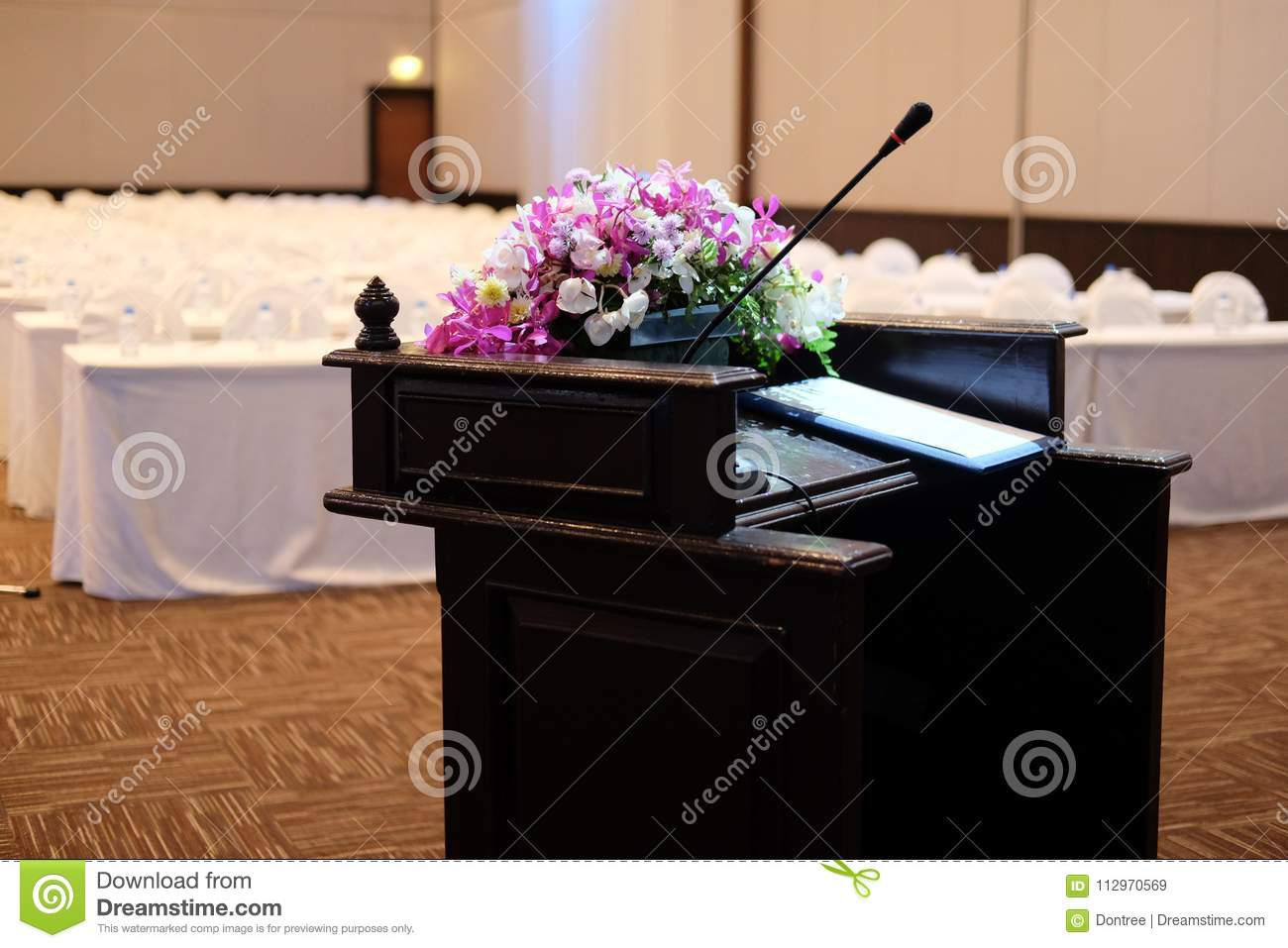Microphone on stand podium decoration with flower stock image royalty free stock photo izmirmasajfo Images