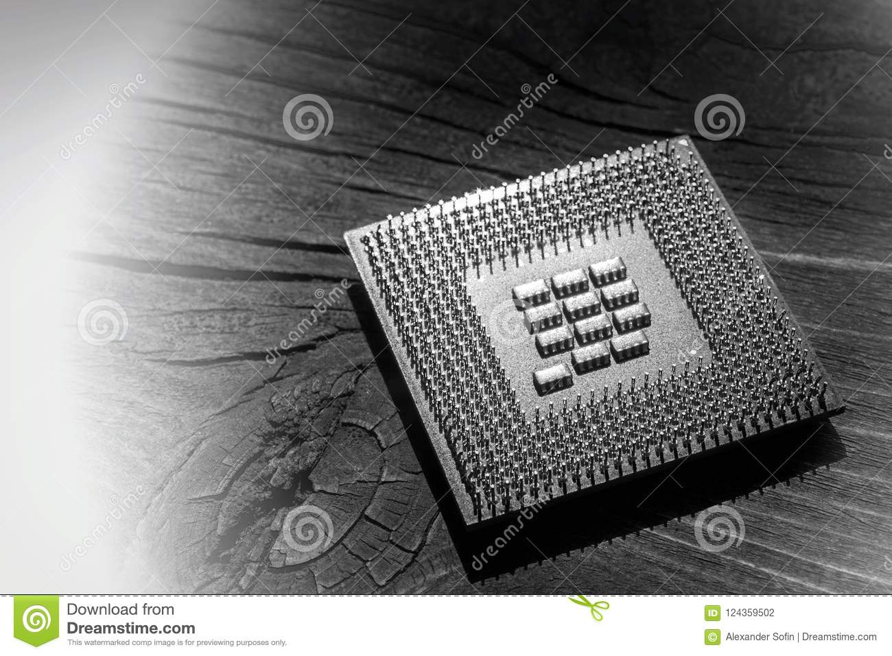 Microprocessor lying on an old cracked board with a knot