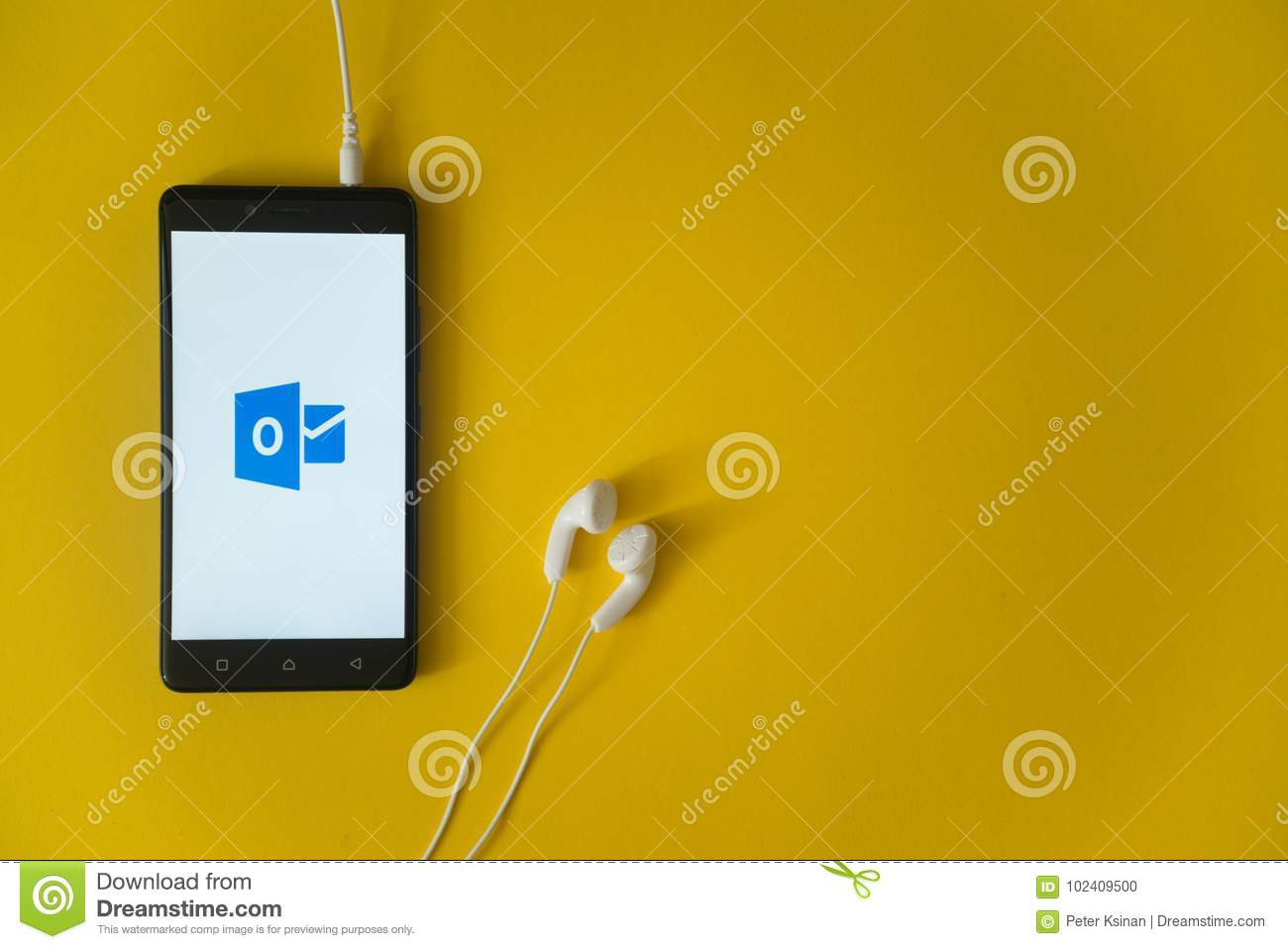Microsoft Office Outlook Logo On Smartphone Screen On Yellow