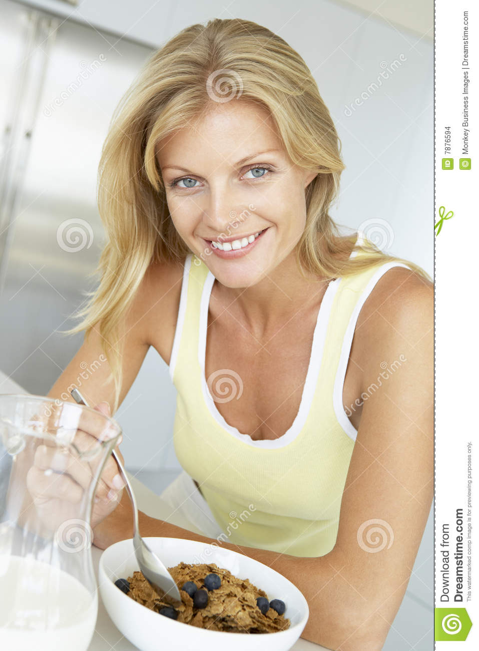 Download Mid Adult Woman Eating Cereal With Fruit Stock Photo - Image of color, diet: 7876594