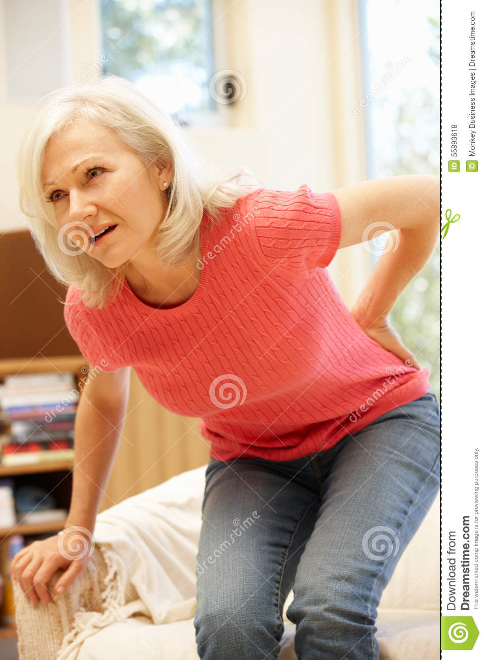 Mid age woman with backache