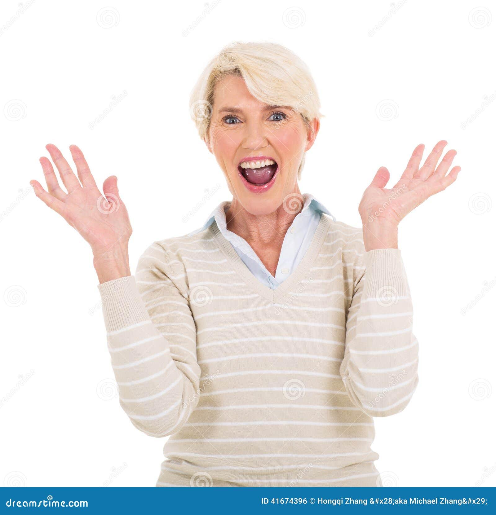 Mid age woman looking surprised