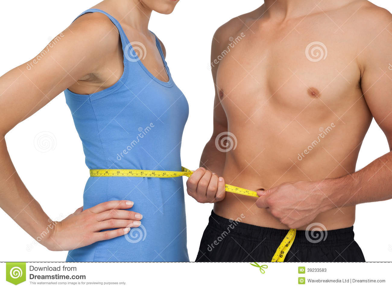 Mid Section Of A Fit Man Measuring Womans Waist Stock Image