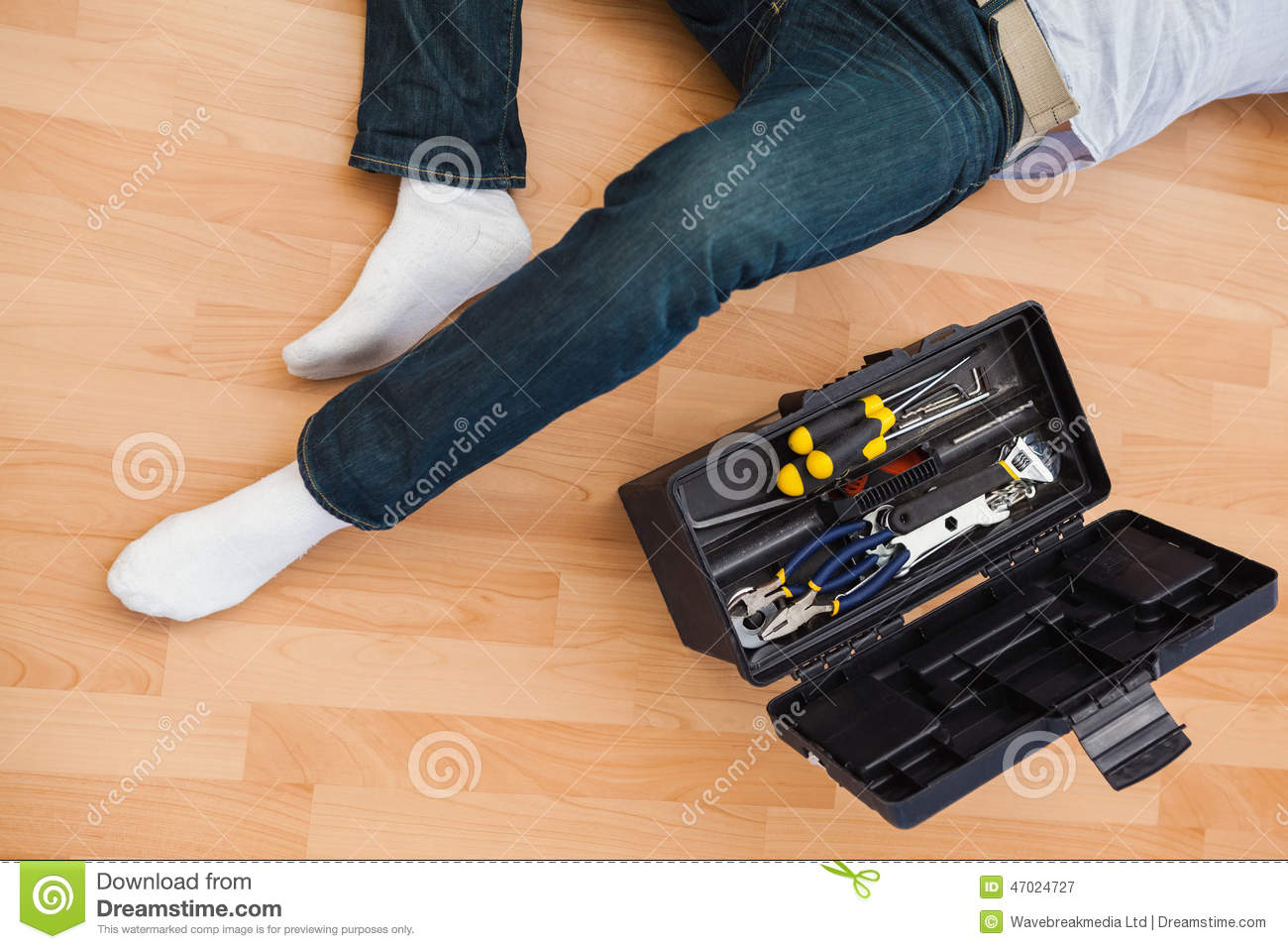 Mid Section Of A Man Lying With Tools Box Stock Image ...