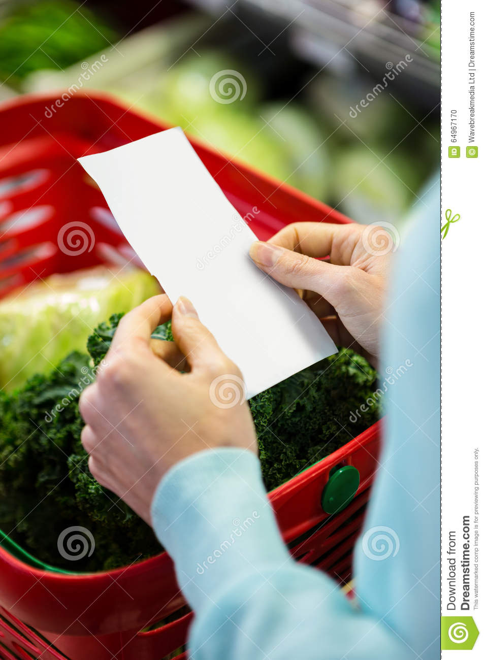 Mid Section Of A Woman With Grocery List Stock Photo ...