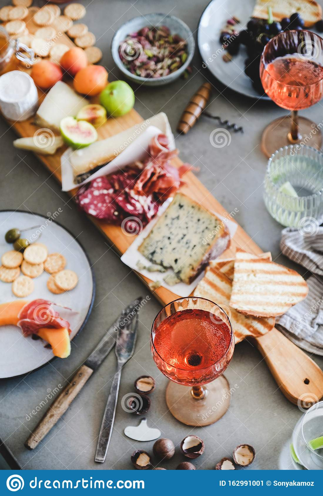 Mid Summer Picnic With Rose Wine Cheese Charcuterie Appetizers And Fruits Stock Image Image Of Olive Board 162991001