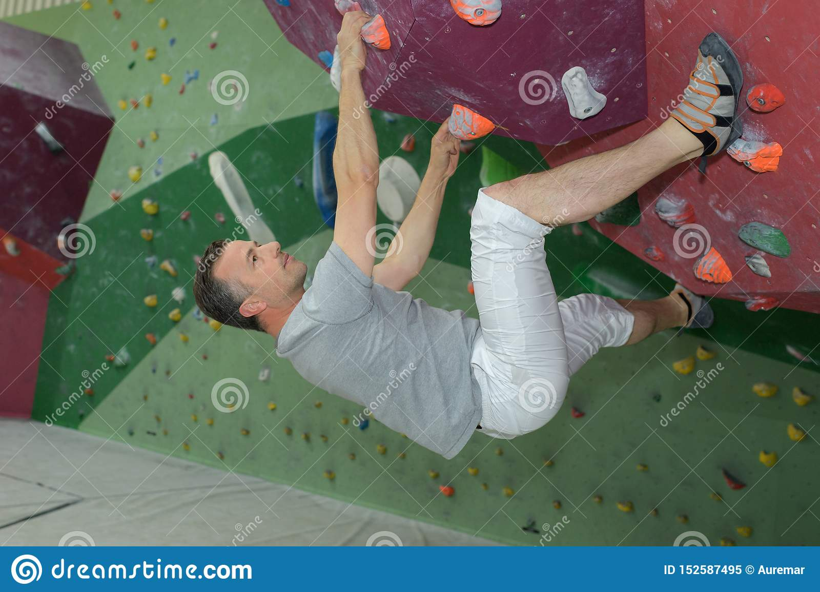 Middle age man on extreme climbing wall