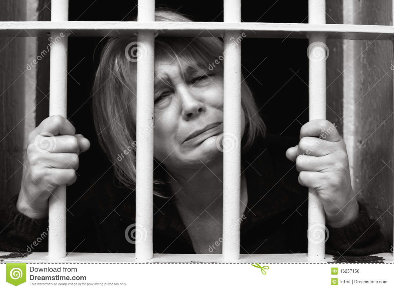 Middle Age Woman Behind Bars