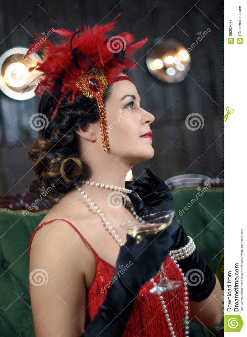 Middle Aged Beautiful Women In Great Gatsby Style With Glass