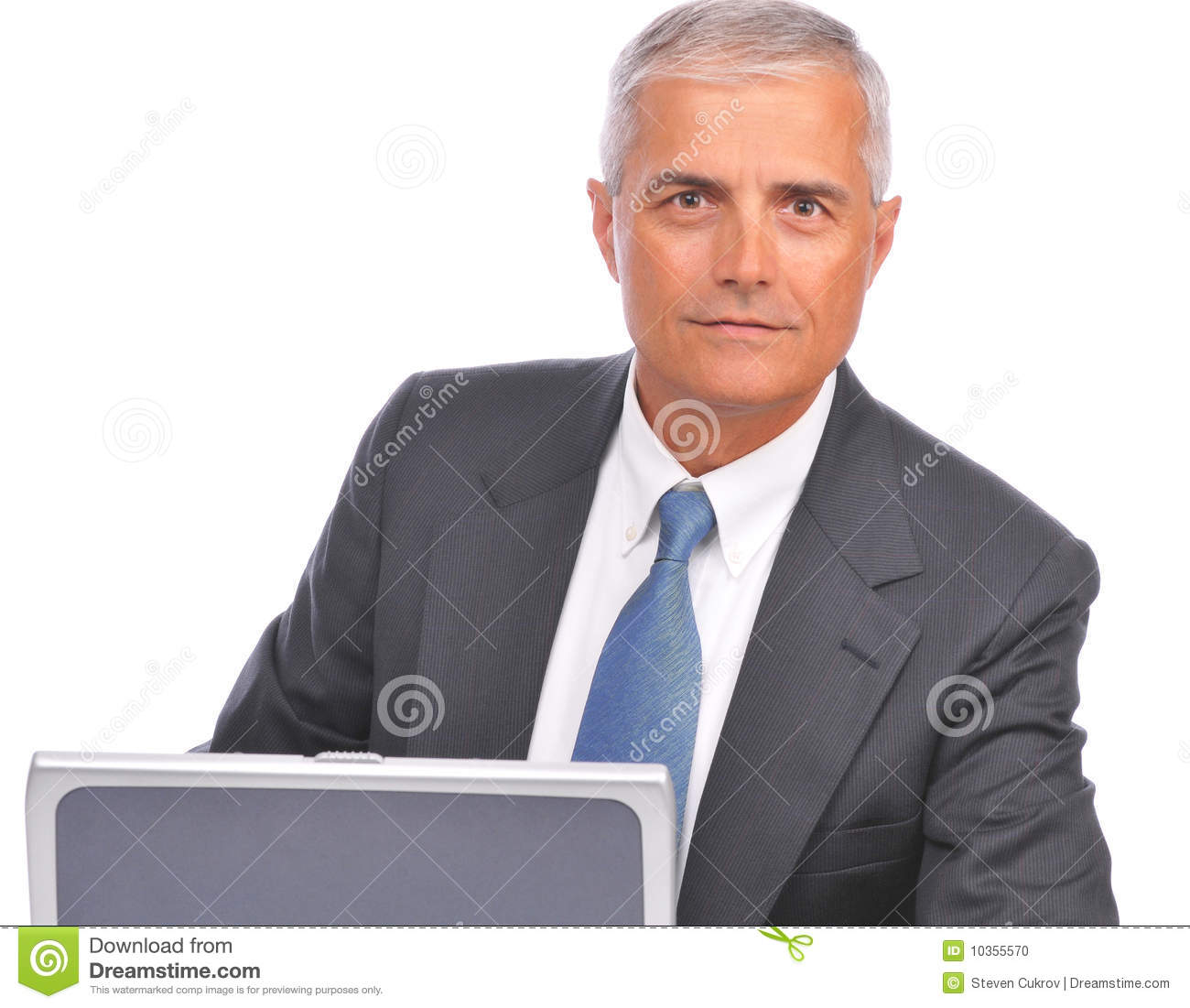 Middle aged Businessman Looking over top of laptop