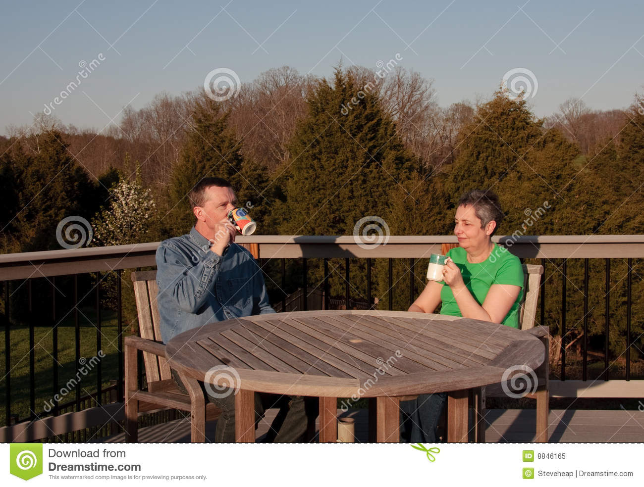 Middle-aged couple relaxing on deck