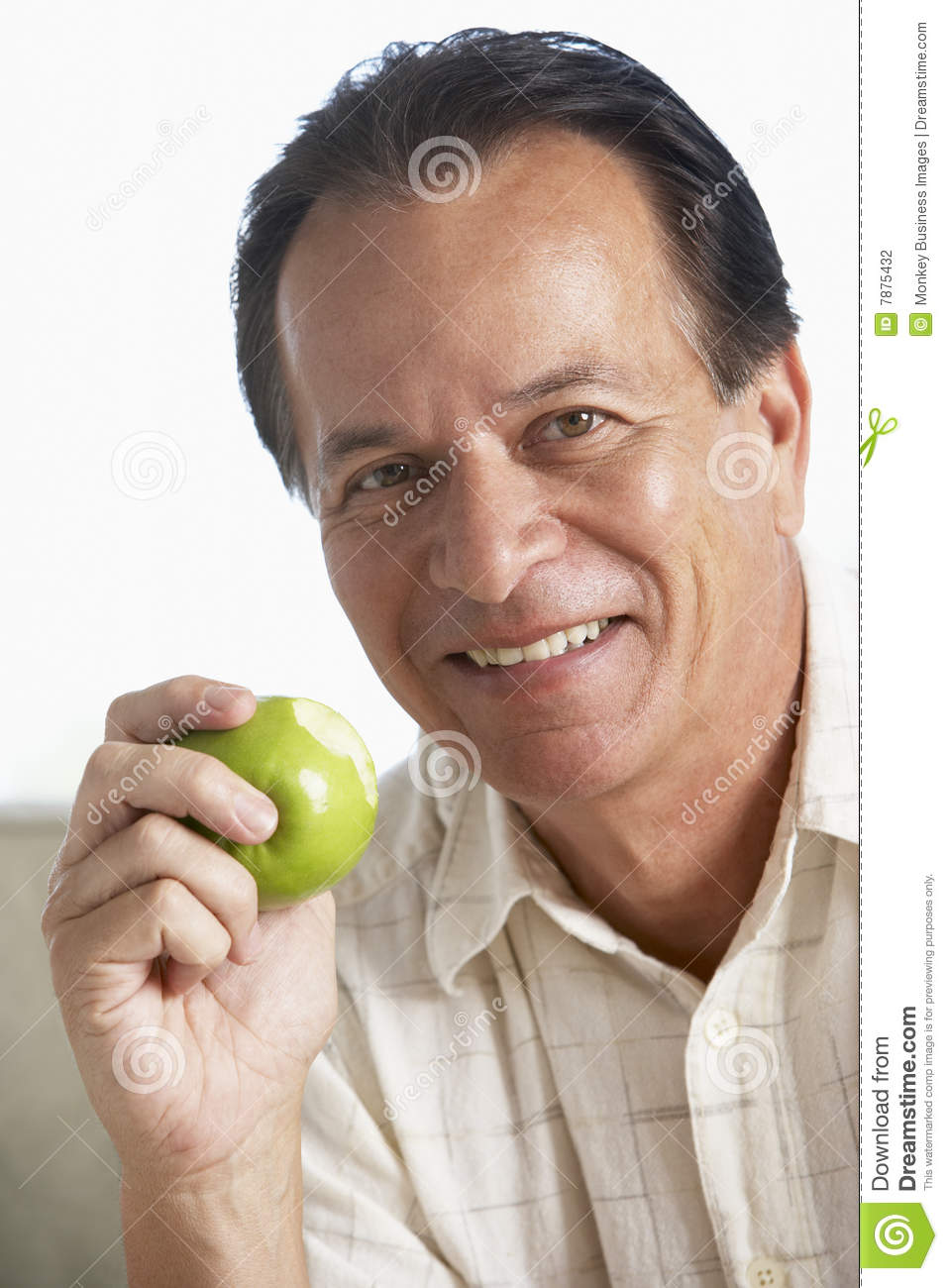 Middle Aged Man Eating Green Apple And Smiling