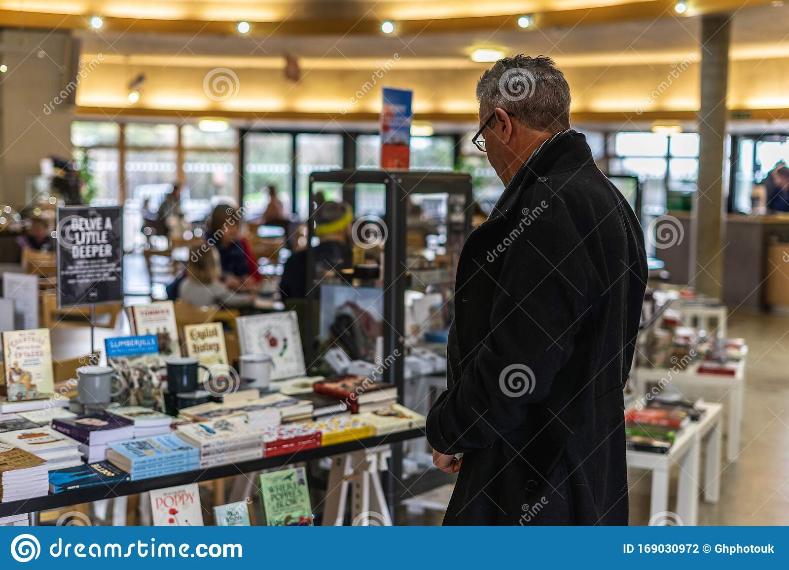 A Middle Aged Man Looking At Items In A Gift Shop Of A Museum Editorial Photography Image Of Stall Shop 169030972