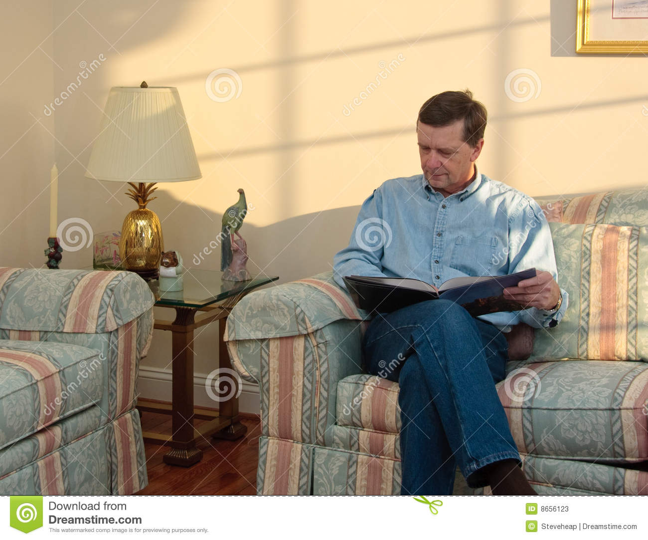 Middle-aged man relaxes on sofa