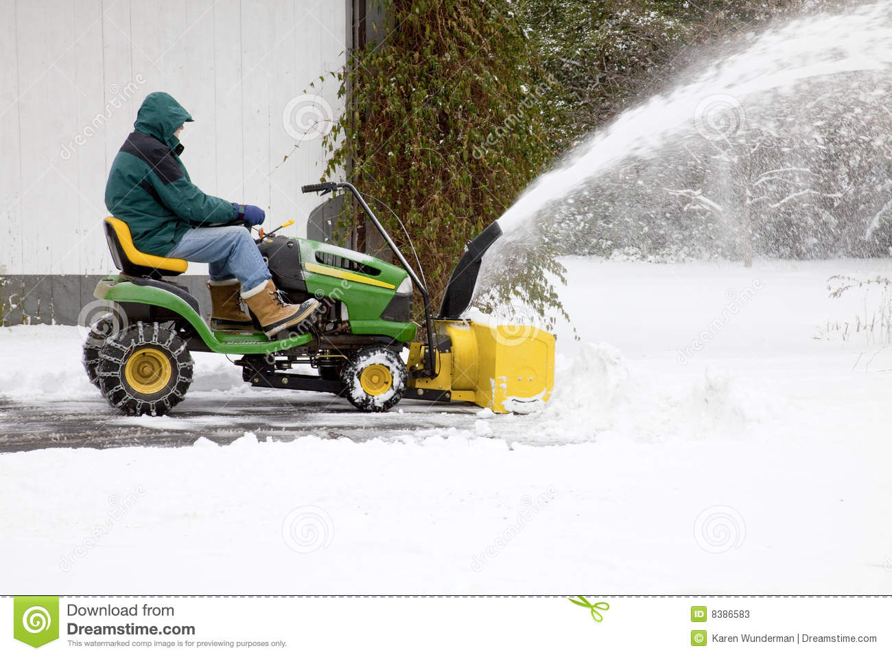 Middle Aged Man On Riding Snowblower Side View Stock