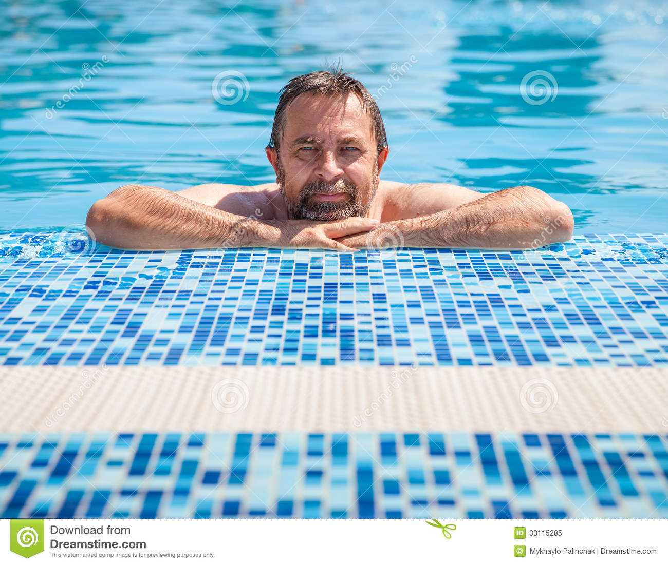 Middle aged man in a swimming pool royalty free stock for Pool man show