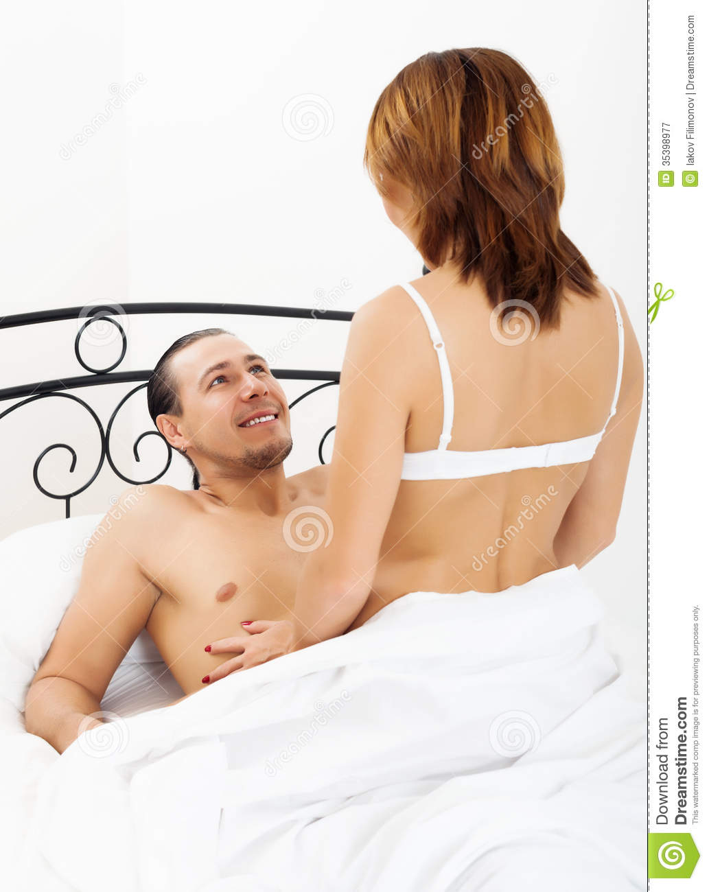 Men having sex with women in bed