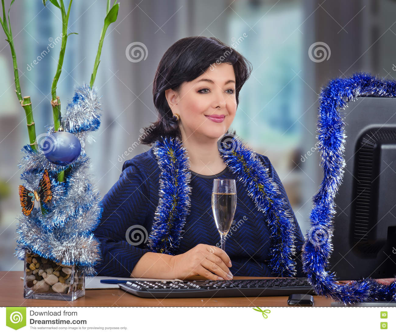 middle aged woman receives christmas greetings online stock image