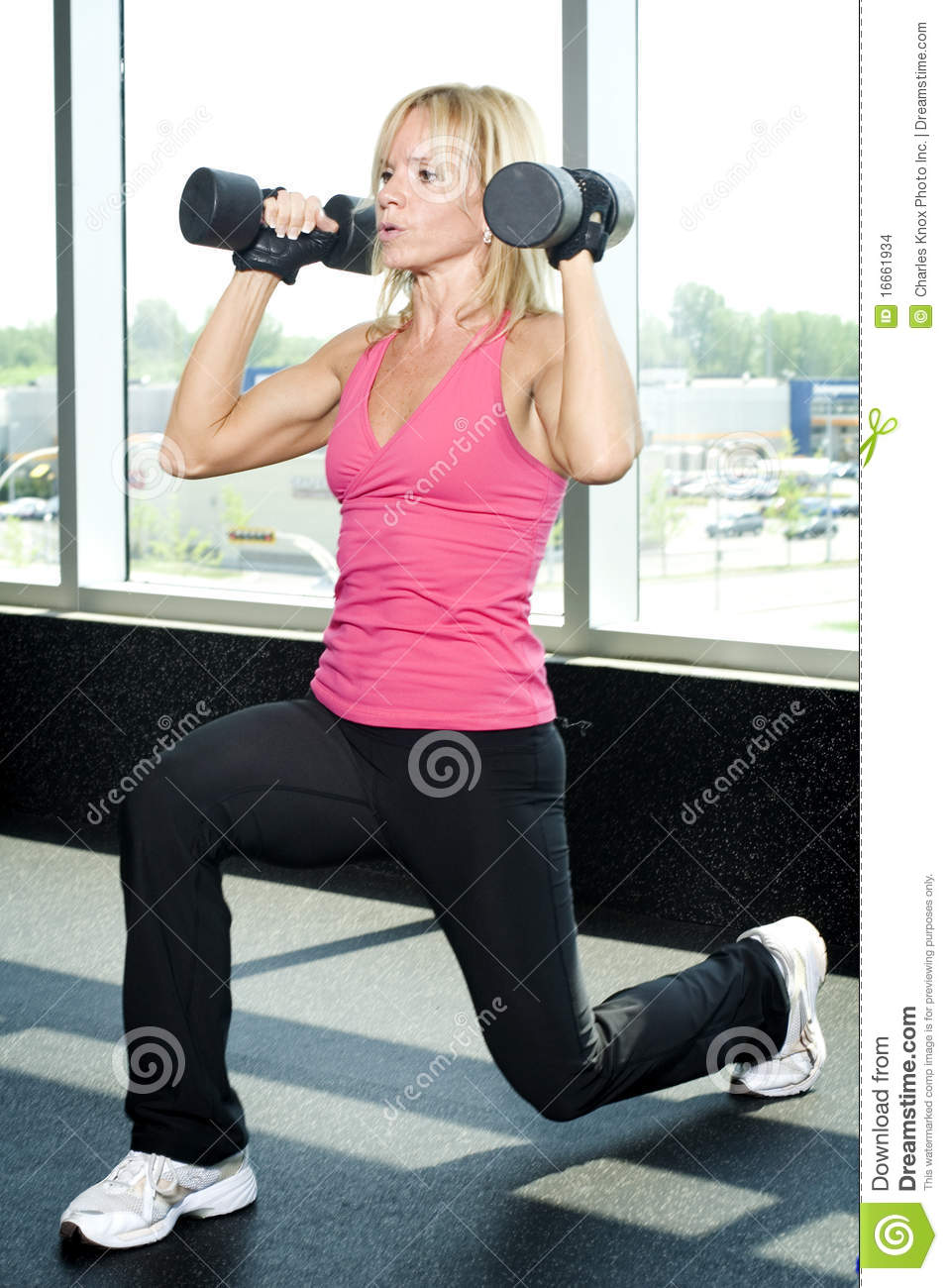 Middle Aged Woman Working Out With Weights Stock Images ...