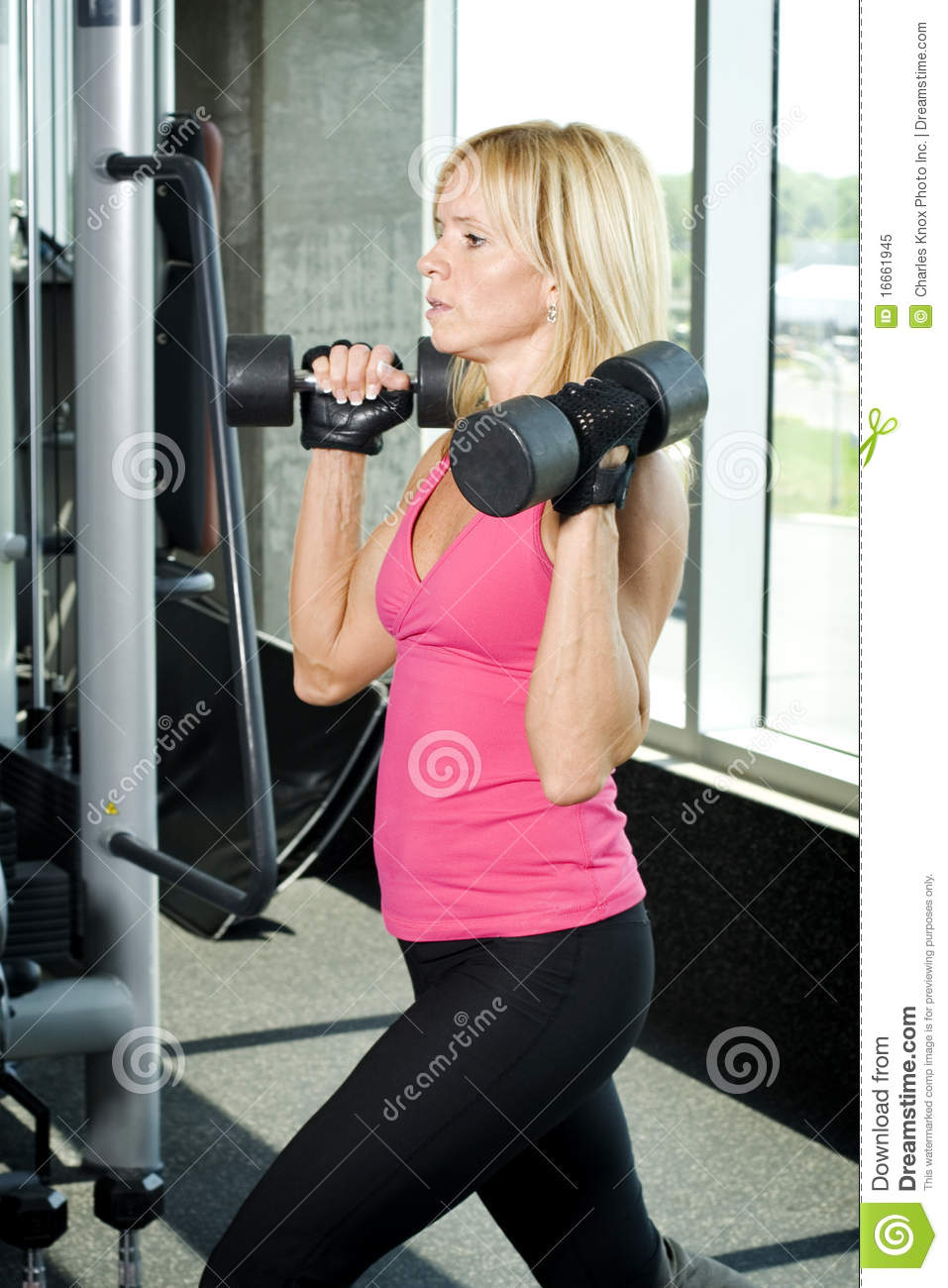 Middle Aged Woman Working Out With Weights Royalty Free ...