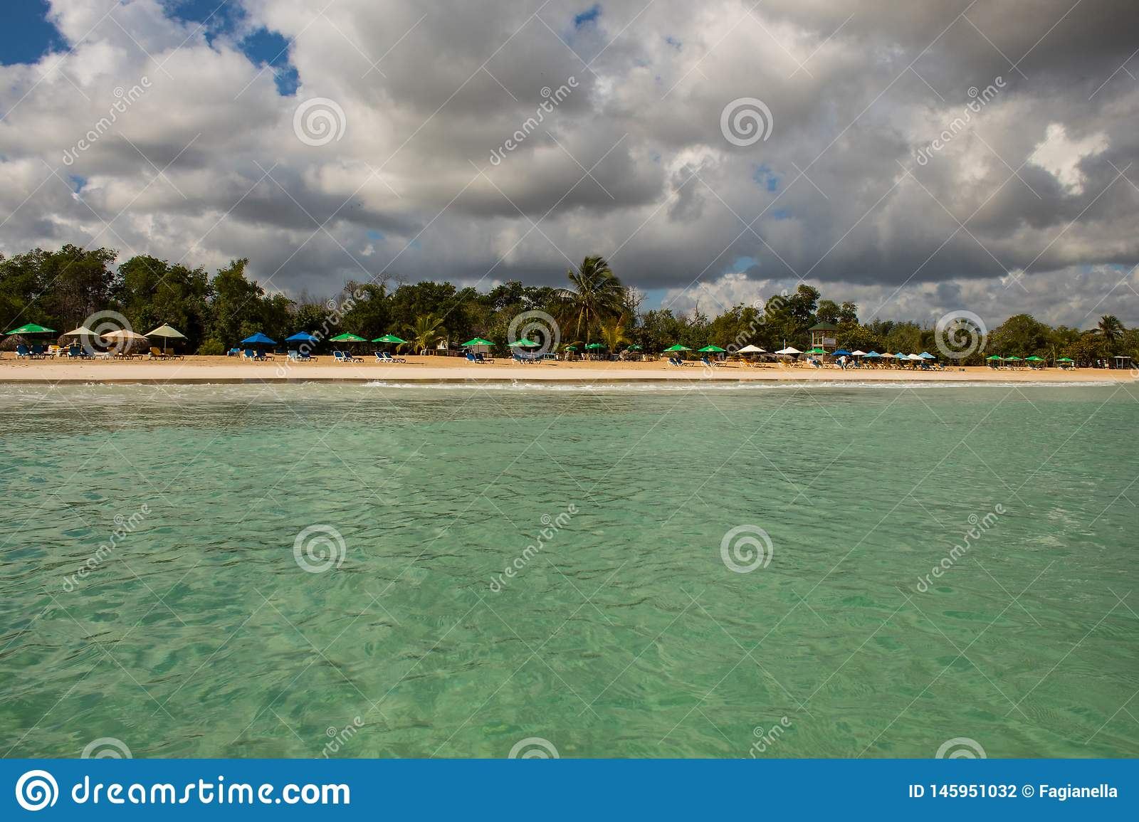 In the middle of an amazing, green and turquoise caribbean sea; transparent water, tropical paradise. Playa Macaro, Punta Cana,