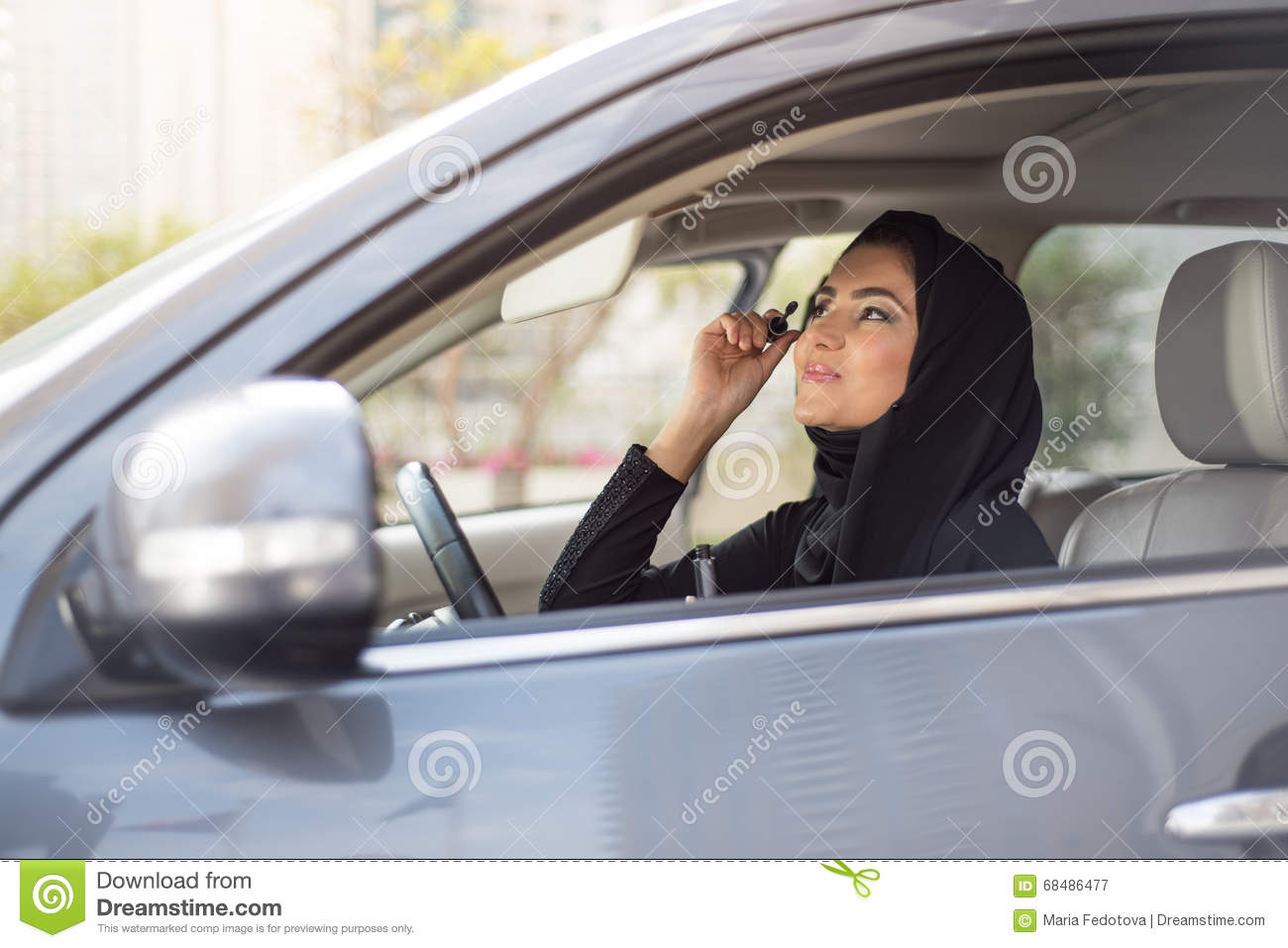 Middle Eastern Women Sitting Inside A Car And Applying ...