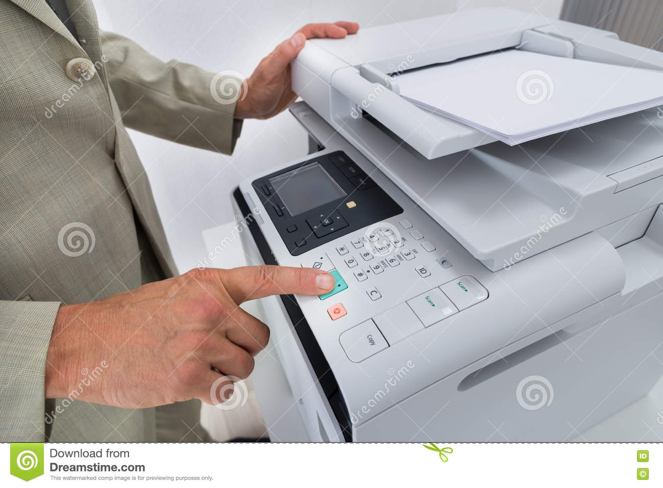 Midsection Of Businessman Pressing Printer s Button