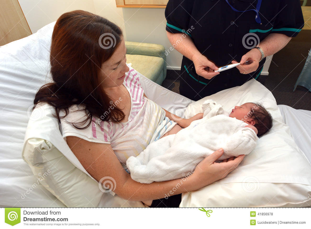 Midwife checking newborn temperature