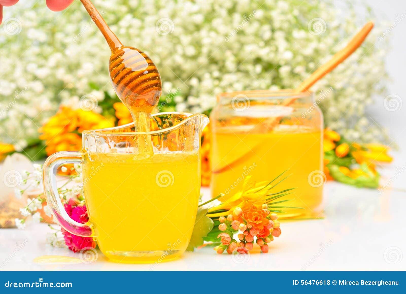 Miel d or versant du bâton en bois