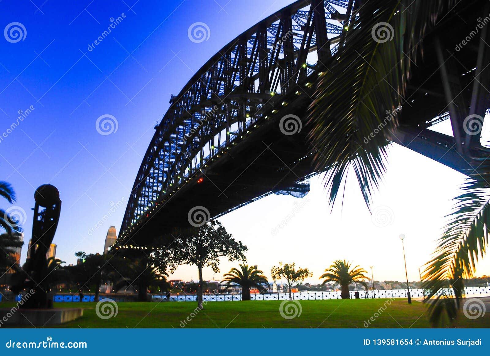 Mighty steel Sydney Harbor bridge crossing the ocean