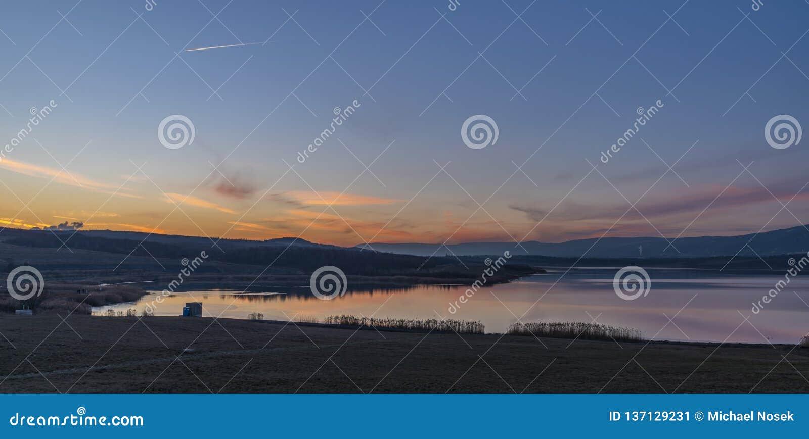 Milada lake in winter cold evening in north Bohemia