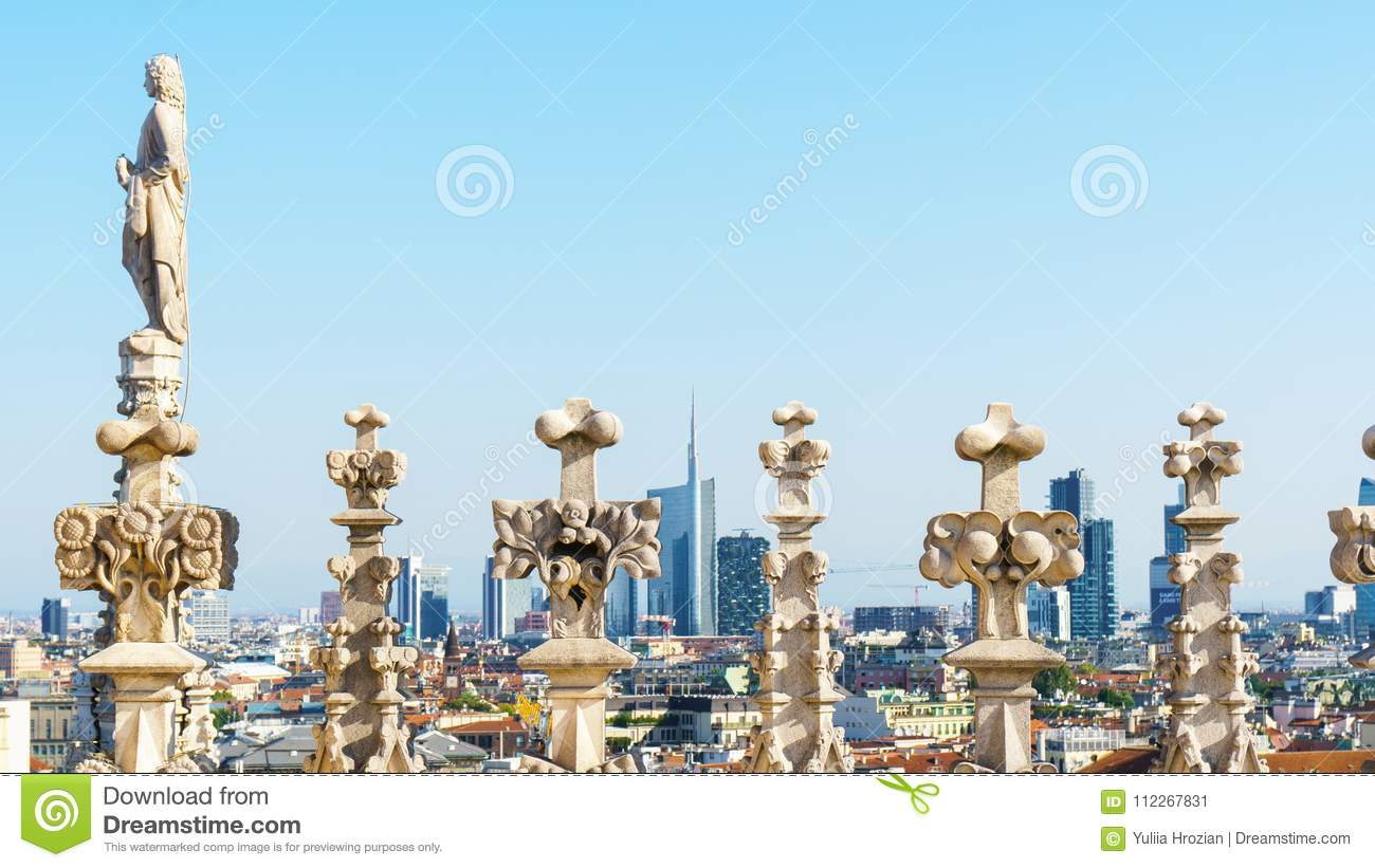 Milan cityscape through sculptures on the roof of Duomo cathedral.