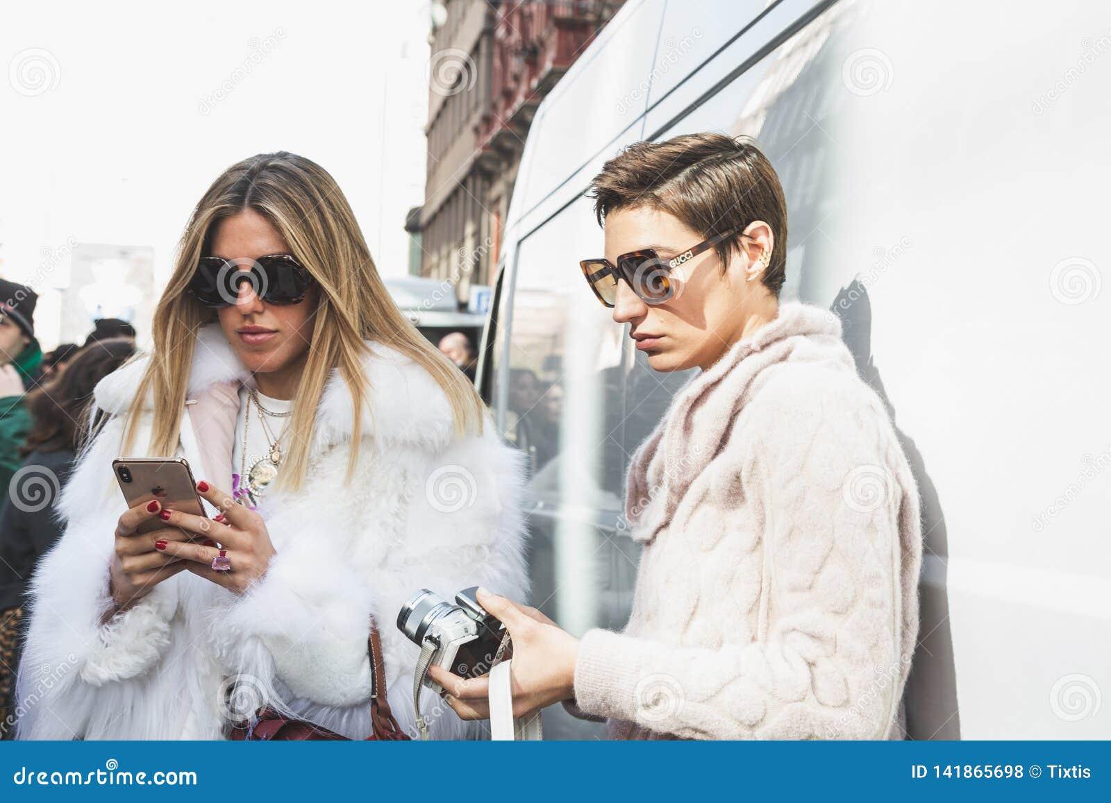 Fashionable people posing during Milan Women`s Fashion Week