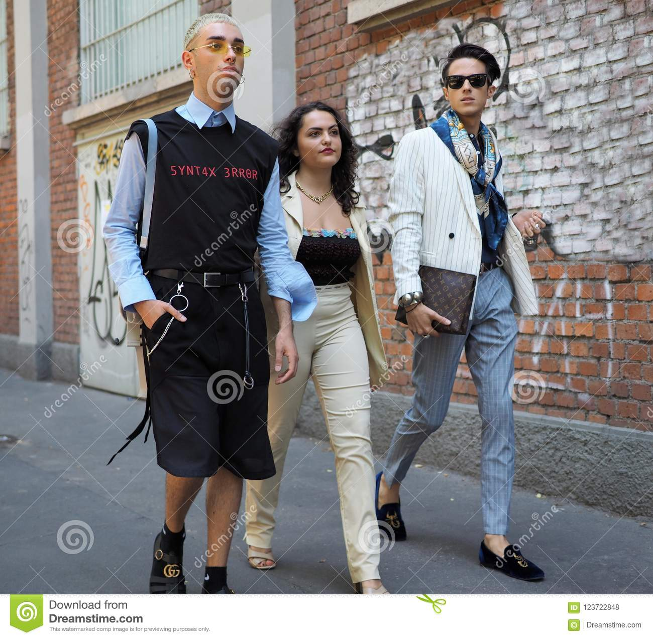 MILAN, ITALY -JUNE 18, 2018: Fashionable people walking in the street before FENDI fashion show