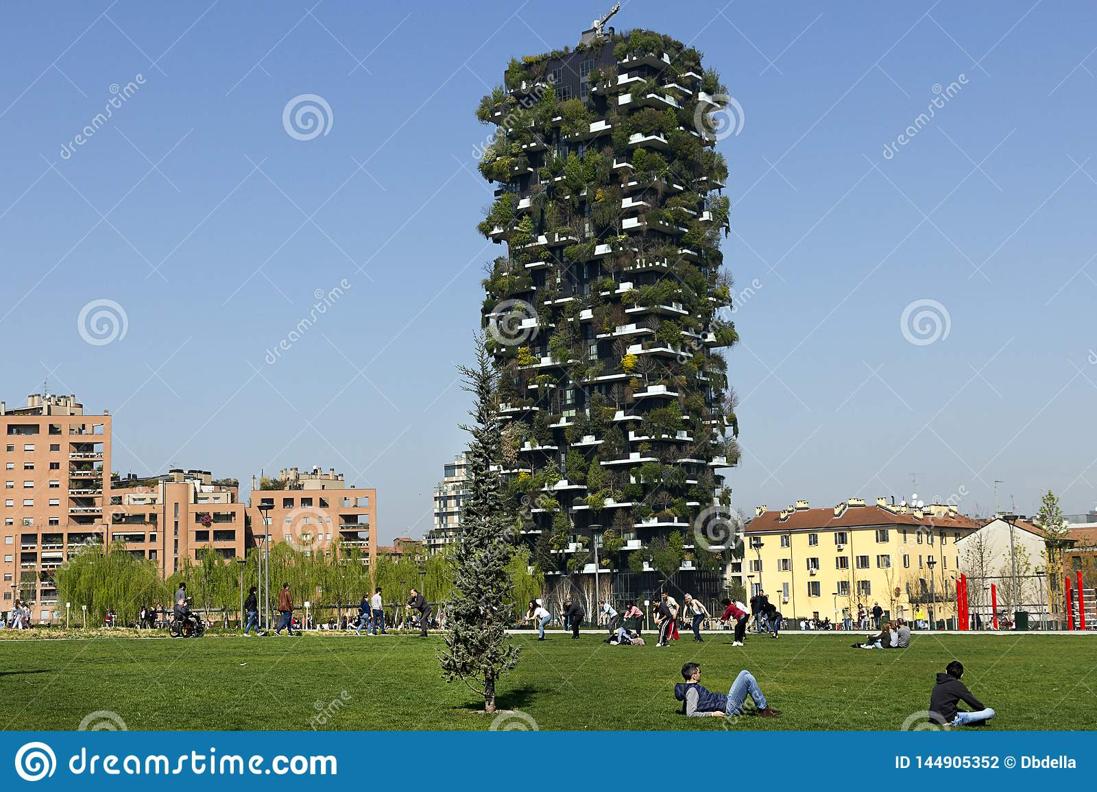 Milan - People enjoy in a spring day in Porta Nuova District, a good time in the large green park. Lombardy Italy