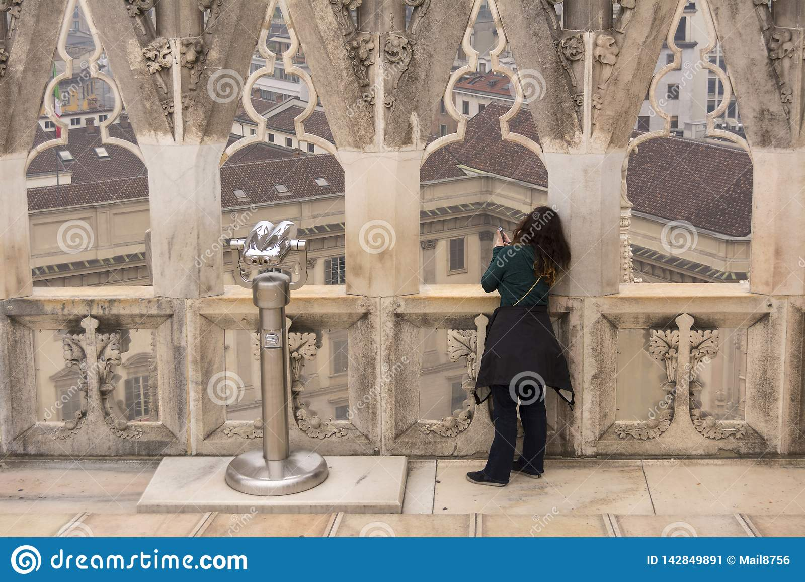 Milan, Italy. 24 nov 2017. On the roof of Milan Cathedral in Italy. Woman takes photos