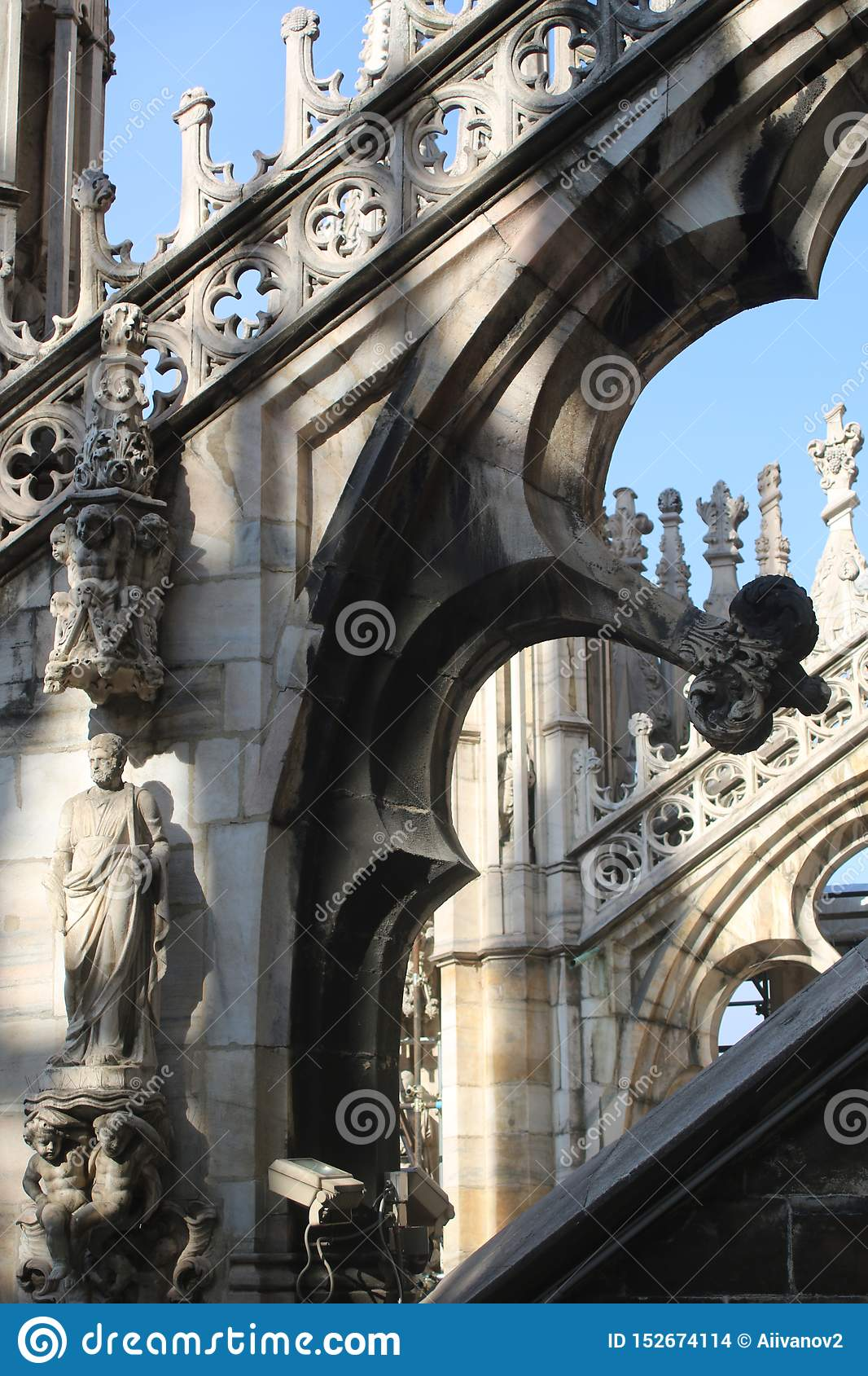 The sculptural decoration and a flying buttresses of the Milan Cathedral