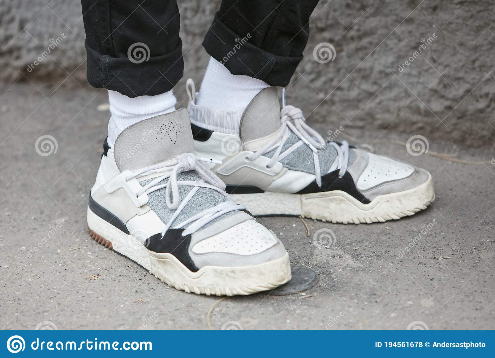 Woman With White, Gray And Black Adidas