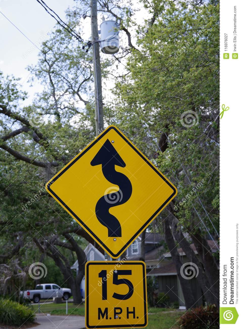 Tampa, Florida / USA - May 5 2018: 15 MPH low angle street sign with the symbol of a squiggly line