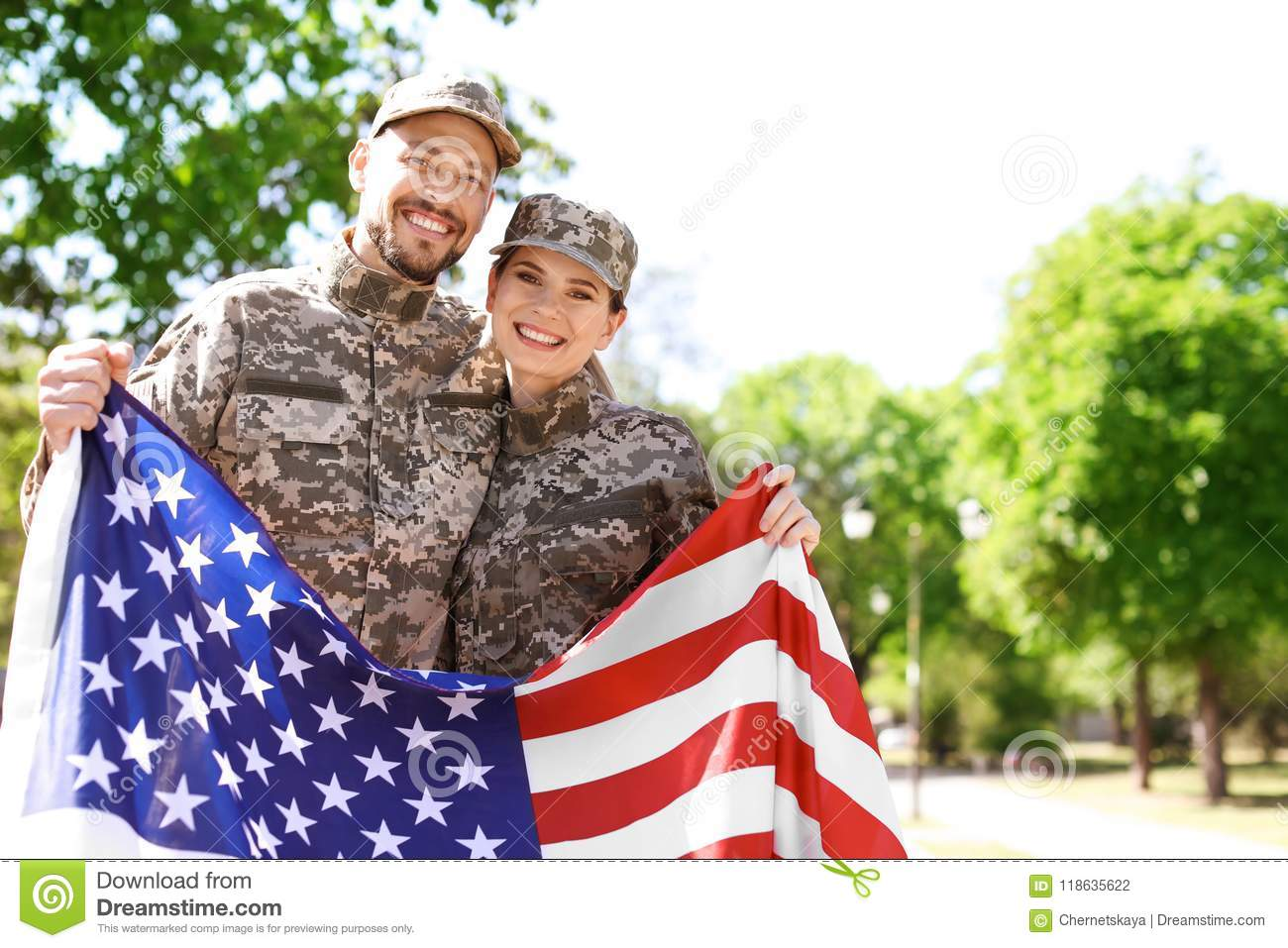 Military couple with American flag