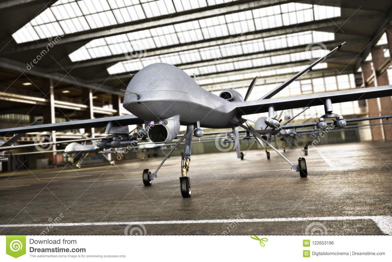 Military Drone UAV aircraft`s with ordinance in position in a hangar awaiting a strike mission.