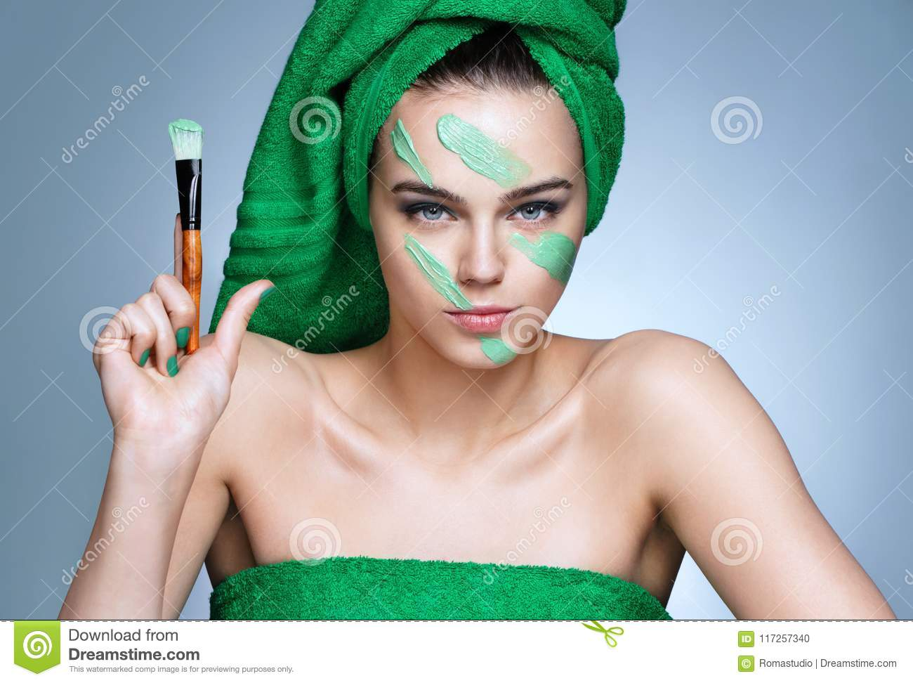 Military facial cream. Serious woman holding up brush.