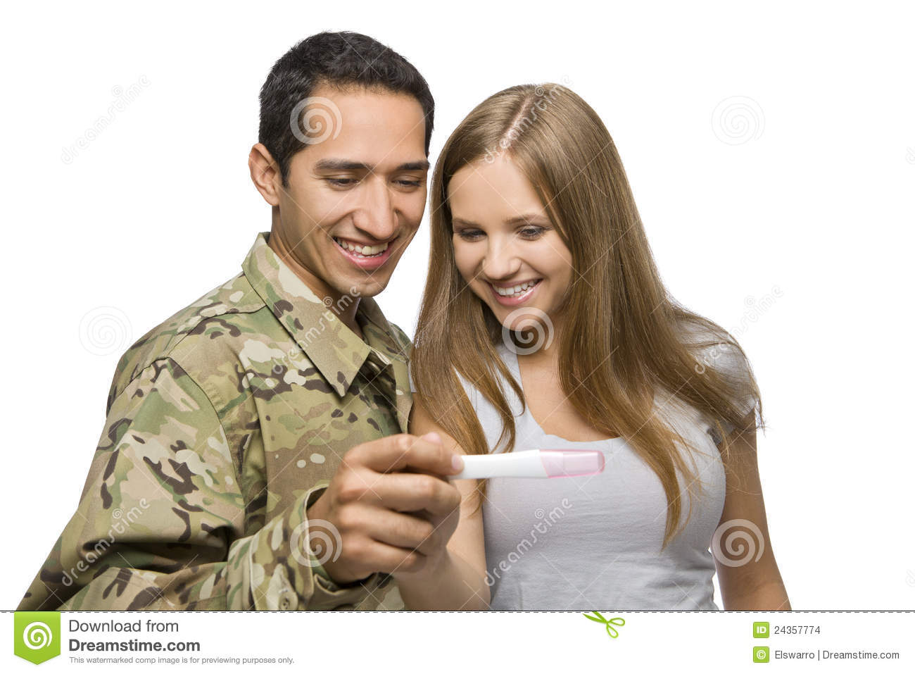 Military Man and His Wife Smile at Pregnancy Test